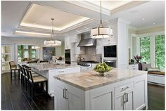 dark floors, white cabinets, light colored countertops...