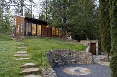 Carve out a private spot with a stone retaining wall. A single stone retaining wall is another option for those with a hill to contend. This works best with a gently sloping hillside; use a terraced-garden approach (such as the one in the previous photo) on steep hillsides instead. - houzz