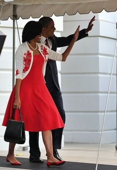 Michelle Obama wears a L'Wren Scott cardigan and Michael Kors Pre-Fall 2012 dress while leaving the White House