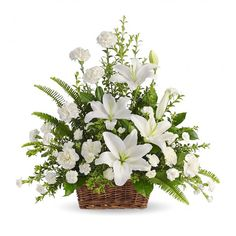 Whether you send this beautiful arrangement to the family home or to the service, all will appreciate its elegance and grace. Gorgeous, fresh flowers such as white lilies, carnations, and miniature ca