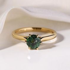 A simple solitaire ring that's a little different and unique. Choosing a green emerald ring is a great way to update a classic engagement ring style with something slightly more alternative. Green Engagement Rings, Emerald Wedding Rings, Green Emerald Ring, Classic Wedding Rings, Classic Engagement Rings, Alternative Engagement Rings, Deco Engagement Ring, Emerald Rings, Art Deco Emerald Ring