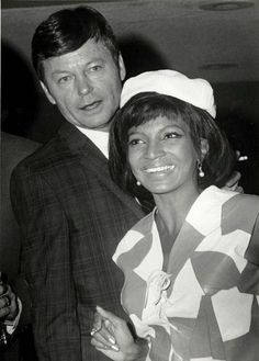 Nichelle and actor DeForest Kelley are caught by paparazzi, 1960's.