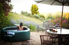 adorable hot tub overlooking lavender garden.. yes please!