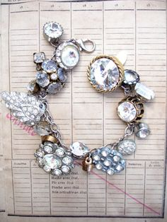 Vintage Rhinestone Button Bracelet Number 35 This bracelet has all vintage rhinestone buttons. There are so many different varieties and sizes, some with lacy bezels, some with clean setting and no prongs, some with gold tone settings, most with silver, all with various signs of age (which we love!)!..