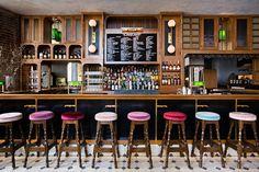 Different colored velvet/velour stools..