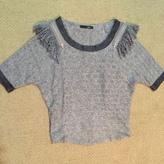 Trendy Boho Sweater Super trendy loose knit sweater (slightly sheer) with leather-like black trip on collar and (3/4) sleeve. Cute zipper and fringe detailing on the shoulders. Sugar Lips Sweaters Crew & Scoop Necks