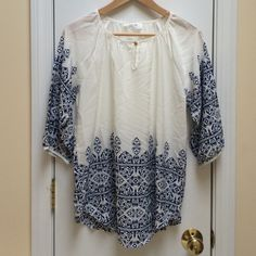 Blue and White Tunic Never worn. Printed tunic top. So cute with white jeans! Tops Tunics