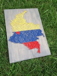 Colombia Colombian Flag Country String Art Home by SheFlutters Colombian Flag, Travel Gallery Wall, Art Projects, Spanish Projects, Flag Country, Flag Art, Flag Design, Vintage Travel Posters, String Art