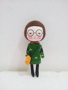 Handmade dark brown hair doll with a carrot bag