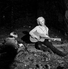 """Marilyn with co-star Tommy Rettig on the set of """"River of No Return"""" in 1954."""