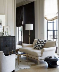 Formal yet comfortable living room- neutral tones, relaxed roman shade. Betsy Brown Interior Design.