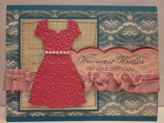 Pretty Provisions:tamps:  Blooming with Kindness, All Dressed Up Ink:  Island indigo, rose red Paper:  Fan Fair DSP, Island indigo Tools:  Big shot, large scallop edgelit, lacy brocade embossing folder, dress up framelits, two tone ribbon, basic pearls,