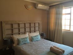 The main bedroom of the Family Room which has a shared bathroom and a twin room for the kids