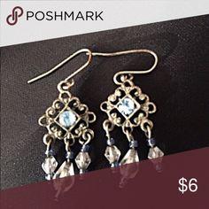 Small Chandelier Earrings Silver toned small chandelier earrings with blue accent beads. Approx. 1 inch long. Jewelry Earrings