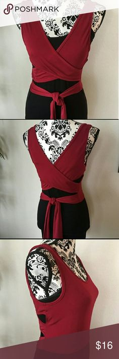 Nwot Wine colored wrap top Size medium  unique wine colored wrap style top that can be worn over clothing like shown in photos (black top not included) or can also be worn alone. Can be worn 2 different styles as shown in pictures 2 & 3. Never worn. Stretchy polyester/spandex knit material. No flaws. If you have any questions please feel free to ask. Offers are welcome. Tops