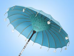 EN The Aqua Turquoise bali umbrella is an excellent choice for the garden or pool side. Original and handcrafted bali parasols for your garden or pool.