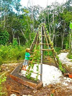 Garden teepee sandbox for the grandbabies.  Have to try this!