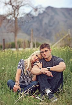 cute pose for engagements. both sitting with his legs up and her indian style, holding his arm and leaning on his shoulder