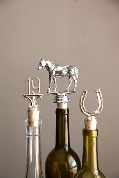 An ingenious hostess gift: Caprock Studio's wine bottle stoppers made from upcycled vintage trophies.