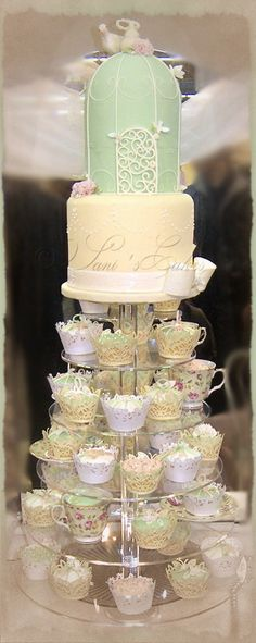 cup a tower and bird cage cake