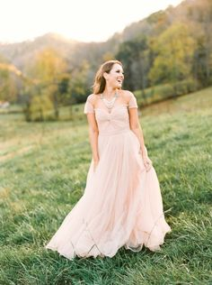 Dreamy blush Reem Acra gown: http://www.stylemepretty.com/little-black-book-blog/2015/03/25/asheville-countryside-engagement-session/ | Photography: Perry Vaile - http://perryvaile.com/