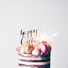 Yay! Here's one insanely fun semi-naked birthday cake we created! It's a Pink Velvet with cream cheese frosting, studded with hot pink macarons, gold sequin macarons, golden chocolate jewels, pink meringue kisses, large sugar pearls, a gold Happy birthday pick and sparklers of course! ✨✨✨