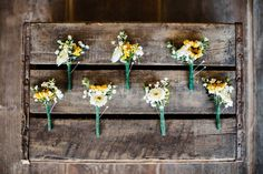 Boutonnieres for a country wedding, placed on an old wooden crate make a truly rustic photo.  photo by Kelcie Jean Photography.