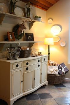dresser or buffet with shelves over it - family room (short wall) or breakfast room
