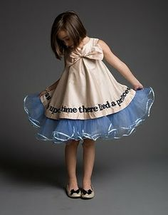 Once upon a time I would have swirled in this once upon a time dress.... and I'm sure someday my little princess will too.