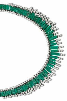 AN EMERALD AND DIAMOND NECKLACE Designed as a line of brilliant-cut diamonds suspending a fringe of graduated baguette-cut emeralds, with twin-diamond terminals at the front, mounted in gold, 42.0 cm