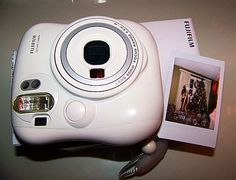 Fuji Instax Mini 25. Love it for scrapbook journals. Instant photo. credit card size.... perfect for journals.