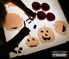 Light table Jack-o-lanterns from Play to Learn Preschool