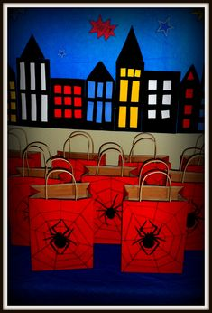 Spiderman gift bags= dollar tree red bags and pre-cut spiders (Halloween section) + black marker webs.  Great for superhero party!