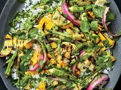 This healthy Indian-spiced salad gets flavor from cilantro-mint chutney which is drizzled over grilled corn cauliflower onions and okra and served over basmati rice. Get the recipe at Food & Wine. Cooking Basmati Rice, Wine Recipes, Grilling Recipes, Okra Recipes, Vegetarian Grilling, Grilling Ideas, Healthy Grilling, Barbecue Recipes