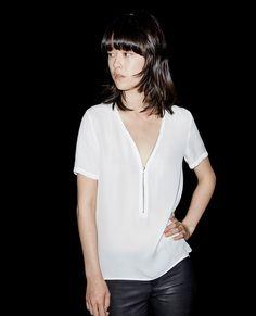 Short-sleeved top with a zip neckline in silk - Tops - The Kooples