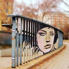 Amazing street art by Zebrating, a creative duo from Mannheim, Germany. Using fences, stairs, railings of Manheim as their canvas, the artists both create original masterpieces and make colorless urban environment live. Zebrating uses a striping technique, very similar to actual zebra's stripes. Most of their work can be seen in Mannheim, however the duo started to hit other cities in Germany such as Berlin and Stuttgart.