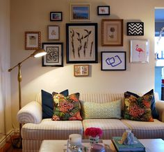 Our new gallery wall, pharmacy style lamp, trellis pillow, and Chiang Mai Dragon Mocha pillows