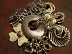 Some of my brooches... I have a great collection. Pending art work...