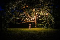 Bride and Groom dancing romantically under a big tree in the night at Monterre Vineyards in Orfield PA Photographed by Sam Rodriguez with SRWEDDINGSTORY wedding photography.