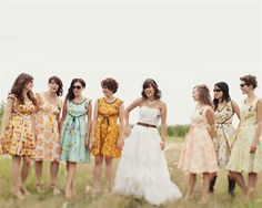 Inspirational Real Wedding Photos The bridesmaids all agreed to a dress pattern and had the same dress made to fit them with different vintage fabrics. And the bride has on a brown leather belt! Vintage Style Bridesmaid Dresses, Printed Bridesmaid Dresses, Wedding Dresses, Floral Bridesmaids, Printed Dresses, Party Dresses, Vintage Dresses, Wedding Bells, Diy Wedding