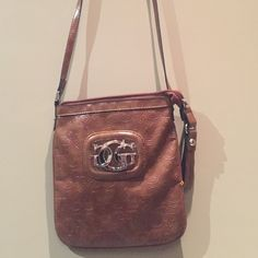 Guess cross body mini bag This Guess cross body mini bag is just the right size to take for a night out or sightseeing, not to small or to big to hold all your essentials. One smaller zippered inside compartment with the Guess logo fabric. Excellent condition! Guess Bags Mini Bags