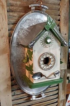 "Sandra's Blingin' birdhouse Sandra says, ""Here is my cedar birdhouse mounted on a vintage tray. Love these darn trays and have a ton of them! I drilled thru a metal coaster for the hole and used silverware, metal leaves and glass pieces to create a charming home for the ""upper crust"" birds!""  Another way To Challenge Yourself Now! Nancy Carter also completed her first project for the January Challenge.  Her birdhouse project has a more 40s look with the old porcelain sauce pans she used for…"