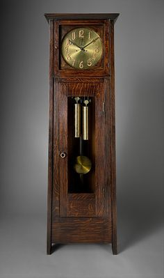 A study in simplicity and proportion, this tall clock embodies the arts and crafts principles of Gustav Stickley. The rectilinear and subtly trapezoidal form, the rich grain of the oak case, and the bold clock face contribute to its successful design Mission Furniture, Craftsman Furniture, Craftsman Clocks, Old Clocks, Antique Clocks, Antique Watches, American Craftsman, Craftsman Style, Craftsman Homes