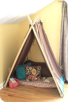 What a neat idea for a little reading/play nook. Kids love having special little spaces like this.