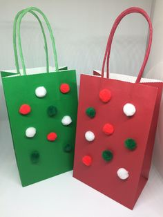 Red and green Pom Pom gift bags, set of four, 2 red, 2 green, 5inx8.5in with handle.  Christmas gift bags, red,green,and white Pom poms by ALittleCraftyGifts on Etsy https://www.etsy.com/listing/546467046/red-and-green-pom-pom-gift-bags-set-of