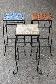 Wrought iron tables with tiles, available in any colour way of your choice.