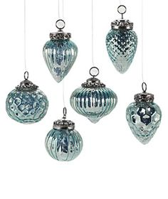Light and elegant mercury glass ornaments add a touch of glimmer and shot of turquoise on the tree.