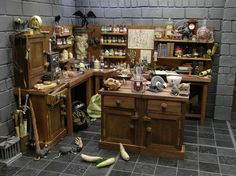Outstanding diorama of a mad scientists lab. Old glass bottles full of poisons and herbs, unusual lab specimens (Siamese twins), body parts being reinvigorated with solution and electricity, antique body diagrams, and rats!