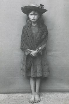 SPITALFIELDS NIPPERS: London's poorest children in the early 1900s – in pictures. So many children did not have shoes to wear or different clothes to change in to. Food was scarce. This little girl poses for picture 'dressed up' in her hat. Her expression gives us an idea about what she may be feeling. I just want to hug her and bring her home to love.♡.•°¨`❤.