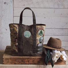 A few weeks ago we found this grungy old hiking pack covered with great patches from the - We knew we wanted to salvag. Green Companies, Unique Bags, Hiking Gear, Clutch Wallet, Leather Bag, Purses And Bags, Reusable Tote Bags, Stuff To Buy, Originals